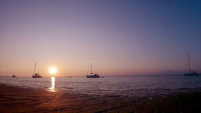 Sunset time-lapse & boat silhouette at Ria Formosa. Algarve. Portugal Royalty Free Stock Image