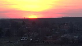 Sunset time lapse over rural village stock footage