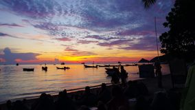 Sunset time lapse with people on the beach and boats. On Koh Tao, Thailand stock video