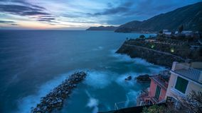 Sunset time lapse of Riomaggiore in Italy. One of the vilages of cinque terre on the coast of Liguria stock footage