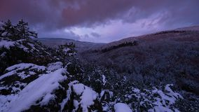 Sunset time lapse of snowy landscape. Sunset view time lapse of snowy mountain forest landscape with fog and clouds. stock video footage