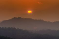 The sunset time and mountain at Wat Phra That Doi Kong Mu Royalty Free Stock Photo