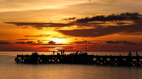 Sunset time by the pier Royalty Free Stock Image