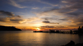 Sunset time by the pier. Twilight scene at Koh Phangan, Thailand Royalty Free Stock Image