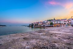 Sunset time in Primosten, Croatia. Sunset colorful view at coastal town Primosten in Croatia, marble tourist place on Adriatic Sea Royalty Free Stock Photography