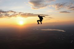 Freefly skydiving. Skydiver is sitting in the sky. royalty free stock photography