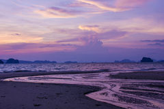 Sunset time and twilight sky. Dusk sky reflects to the beach at Tub Kaek beach, Krabi province, Thailand Royalty Free Stock Image