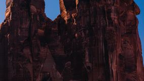 Sunset over Rock Formation in Arches National Park, Utah. Sunset timelapse in Arches National Park. The sun sets as the camera pans up to the top of The Three stock footage