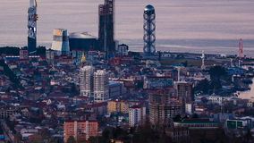 Sunset timelapse Batumi cityscape pan up. HD Sunset timelapse Batumi cityscape, pan up shot stock footage