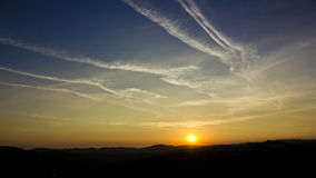 Sunset timelapse and chemtrails stock video