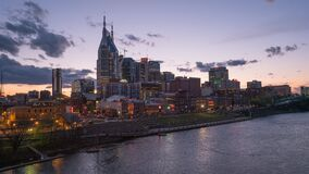 A sunset timelapse of the city of nashville from a bridge across the cumberland river, tennessee
