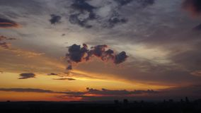 Sunset timelapse clouds colorful and building stock footage