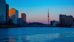 Sunset timelapse day to night at Sumida river in Tokyo zoom stock video