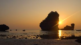 Sunset Timelapse over the Rocks in the Sea at Thailand, Phi-phi island, Nui Bay Lagoon. 4k UHD stock video footage