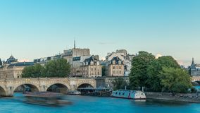 Sunset timelapse over Seine river, Pont Neuf bridge and Cite island with Royal palace, Conciergerie and medieval stock video