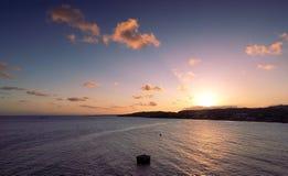 Sunset on Tobago island - Caribbean sea. Republic of Trinidad and Tobago - Sunset on Tobago island - Scarborough city near the harbor - Caribbean sea stock photo