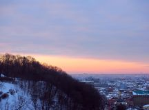 Sunset today in big city, Kiev, Ukraine. Town under snow, sunset time. Stock Photography