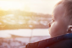 Sunset and toddler. Winter sunset and toddler who looking back with serious face Royalty Free Stock Images
