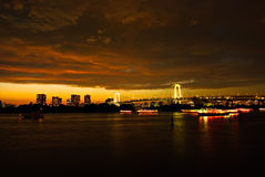 After sunset at Tokyo viewed from Odaiba under dark clouds. Stock Photo