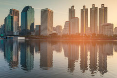 Sunset tone, city office building over water reflection Royalty Free Stock Image