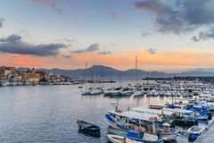 Sunset in Torre del Greco port near Naples, on background Sorrento peninsula. Campania, Italy Royalty Free Stock Images
