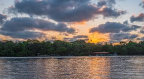 Sunset in Tortuguero - Costa Rica. Orange sky, clouds royalty free stock photo