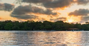 Sunset in Tortuguero - Costa Rica. Yellow sky some clouds stock photography