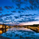 Sunset in Toulouse, France. Toulouse, France. Hotel de Ville, Pont Saint Pierre (Saint Pierre bridge Stock Images
