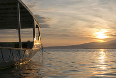 Sunset with tourist boat and still water on Gili Air Island, Ind Stock Photography