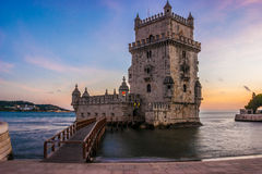 Sunset at the Tower of Belem, Lisbon. Tower of Belem at sunset on the Tagus River in Lisbon, capital of Portugal Royalty Free Stock Images