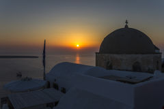 Sunset at the town of Oia in Santorini, Greece Royalty Free Stock Image