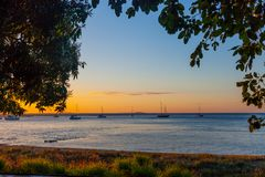 Sunset at Seventeen Seventy, Queensland. Sunset in the town of Seventeen Seventy, Queensland, Australia. Ocean`s promenade overlooking anchored yachts stock photography