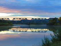 Sunset Tracks. Sunset over the Green River Train Tracks. Here at the bend in the river is where the water is calm enough to give a mirrored surface. The sky is Stock Image