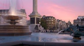 Sunset on Trafalgar Square. Sun setting over Trafalgar Square, London, UK Stock Photo