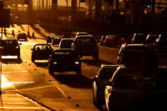 Sunset traffic. Traffic in a golden light Stock Photo