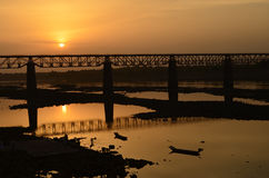 Sunset with a train bridge at narmada river near indore, india-2015. Sunset at narmada shore omkareshwar m.p., india Royalty Free Stock Image