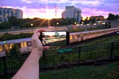 Sunset at the train station. The DC metro pulls into Grosvenor Strathmore metro Stock Photos