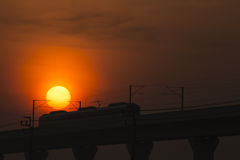 Sunset&Transport. The electric train run pass the sun in twilight time Royalty Free Stock Photography