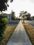 Sunset tree shadow on a road. At Temple City, Los Angeles, California Royalty Free Stock Photo