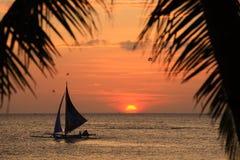 Sunset of tropic island Stock Photos