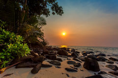 Sunset on a tropical beach Royalty Free Stock Images