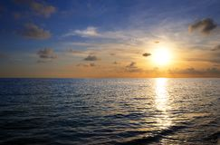 Sunset on tropical beach Royalty Free Stock Photography