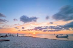 Sunset on tropical beach in Isla Mujeres, Mexico Royalty Free Stock Photography