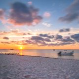 Sunset on tropical beach in Isla Mujeres, Mexico Royalty Free Stock Photo