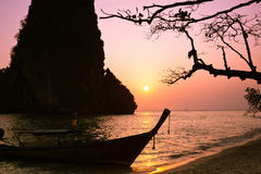 Sunset at tropical beach landscape with Thai traditional boat an Royalty Free Stock Image