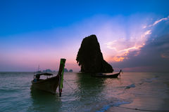 Sunset at tropical beach landscape. Thai traditional long tail b Stock Image