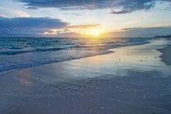 Sunset on tropical beach Stock Image