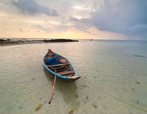 Sunset at tropical beach with Thai fishing boat Royalty Free Stock Photo