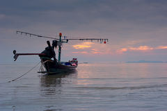 Sunset at tropical beach with Thai fishing boat Royalty Free Stock Photos