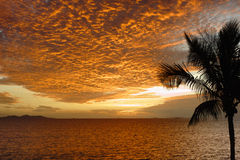 Sunset in tropical Fiji. Looking out towards the sun setting over the Mamanuca Islands, in tropical Fiji stock image